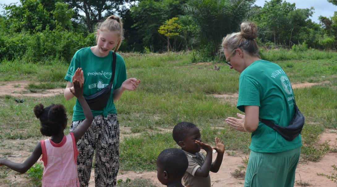 Danish mother and daughter play games with the children in Ghana